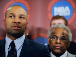 National Basketball Players Association president Derek Fisher, left, and executive director Billy Hunter, right, sent a letter to players Monday after the union rejected the NBA owners' last proposal.