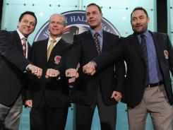 2011 inductees Doug Gilmour, Mark Howe, Joe Nieuwendyk and Ed Belfour show off their Hall of Fame rings Monday.