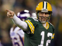 Rodgers, PACKERS thump Vikings to stay unbeaten
