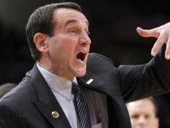 Coach Mike Krzyzewski shouts instructions during Duke's game against Michigan State. The Blue Devils won, giving Krzyzewski win No. 903.