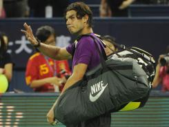 Rafael Nadal of Spain was drawn together with Roger Federer in Group B at the ATP World Tour Finals.