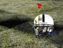 A rose is secured in a Penn State helmet after the team clinched a spot in the 2009 Rose Bowl. After the child sex abuse scandal, the university should turn down any bowl bid this season.