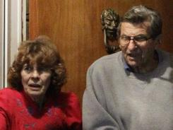 Joe Paterno and his wife, Susan, come to the doorway of their home to thank supporters gathered outside on Nov. 9.