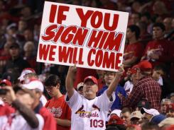 During a playoff game last month, a Cardinals fan makes his feelings known about whether the club should re-sign Albert Pujols.