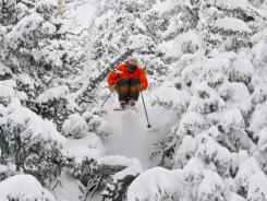Jamie Pierre, here performing an extreme jump, was killed while snowboarding near Gad Valley on Sunday.