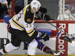 Montreal's Max Pacioretty suffered a fractured vertebra on this hit by Zdeno Chara.