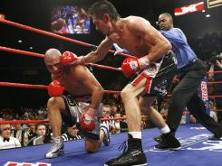 Miguel Cotto, left, took a beating during his fight against Antonio Margarito in July 2008. Margarito won on an 11th-round TKO.