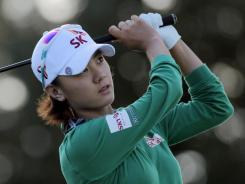 Na Yeon Choi of South Korea watches her tee shot on the 17th hole during the first round of the CME Group Titleholders.