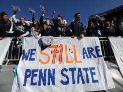Penn State students cheer Saturday during the game against Nebraska, the first home game since the child abuse scandal broke. Defensive tackle Devon Still wears No. 71 for the Nittany Lions.
