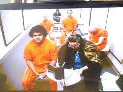 Great Fallls, Mont., offensive lineman Alex Botina-Roehm makes his initial appearance before Judge Neill via video from the Cascade County Jail, Tuesday afternoon. Roehm is charged with felony sexual intercourse without consent and two counts of misdemeanor sexual assault .