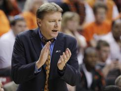 Oklahoma State women's basketball coach Kurt Budke was killed, along with assistant coach Miranda Serna, in a plane crash in central Arkansas on Thursday.