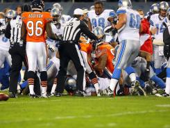 A fight breaks out between the Chicago Bears and the Detroit Lions during their game in Chicago on Sunday.
