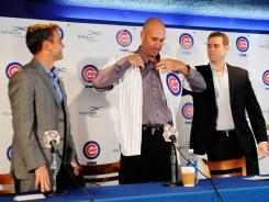 Dale Sveum, left, is introduced as the next Cubs manager.
