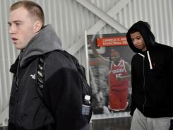 Syracuse basketball players Trevor Cooney, left, and Michael Carter-Williams arrive for basketball practice Friday. Players did not want to comment about accusations made against assistant coach Bernie Fine.