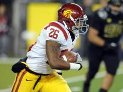 USC running back Marc Tyler gains a first down during the Trojans 38-35 upset over No. 4 Oregon.