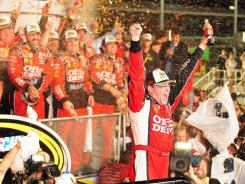 Tony Stewart celebrates his race win and championship in victory lane at Homestead-Miami Speedway.