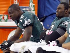 Eagles wide receiver Jeremy Maclin (18) and quarterback Michael Vick sit on the bench during an , Oct. 2 loss to the 49ers in Philadelphia. Neither player will suit up against the Giants on Sunday.