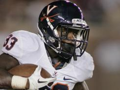 Virginia's Perry Jones looks for room to run against Florida State on Saturday night. The Cavaliers upset the No. 22 Seminoles 14-13.