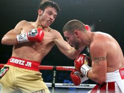 "WBC Middleweight Champion Julio Cesar Chavez Jr., left, stopped "" Peter Manfredo Jr. in the fifth round Saturday in Houston to remain undefeated,"
