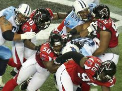 The Falcons limited Titans RB Chris Johnson (28) to 13 yards on 12 carries Sunday.