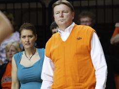 Oklahoma State women's basketball coach Kurt Budke, right, and assistant Miranda Serna died in a plane crash Thursday.