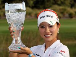 Hee Young Park of South Korea shows off her prize after winning the CME Group Titleholders on Sunday in Orlando.