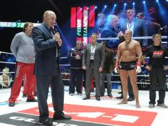 Russian Prime Minister Vladimir Putin, second from left, congratulates fighter Fedor Emelianenko, second from right, after his victory Sunday in Moscow.