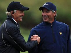International captain Greg Norman shakes hands with U.S. captain Fred Couples.