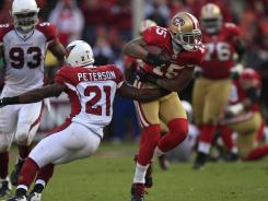 San Francisco 49ers wide receiver Michael Crabtree gets past  Arizona Cardinals cornerback Patrick PetersonSunday. Crabtree had seven catches for 120 yards.