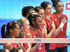 Members of the U.S. women's volleyball team sing the national anthem prior to their FIVB World Cup match against Italy. Team USA beat Italy then lost to Japan and won the silver medal.
