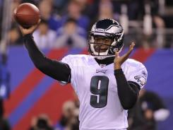 Filling in for injured starter Michael Vick, Vince Young threw a pair of touchdown passes to lead the Eagles past the division-rival Giants.