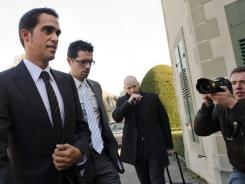 Three-time Tour de France champion Alberto Contador (left) arrives flanked by his brother Fran (center) and his laywer Mike Morgan at his hearing at the Court of Arbitration for Sports on Monday in Lausanne.