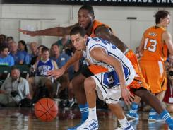 Guard Seth Curry (front) shields the ball away from an unidentified Tennessee player during their first-round matchup at the Maui Invitational. Curry was one of four Blue Devils in double figures Monday night.