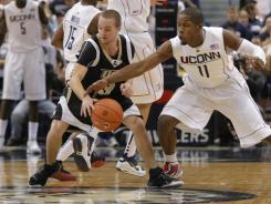 Connecticut Huskies guard Jerome Dyson (11) works to steal the ball from Central Florida Knights guard A.J. Rompza (3) during the second half at the XL Center during the 2009-10 season.