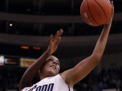 Connecticut forward Kaleena Mosqueda-Lewis (23) grabs a rebound against Stanford during second-half action Monday night. Mosqueda-Lewis had 25 points in the victory for the fourth-ranked Huskies.