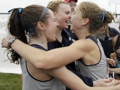Georgetown runners, including Hannah Neczypor, left, and Claire Richardson, celebrate the program's first national title.