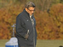 Joe Paterno walks the practice field on his final day as Penn State football coach.