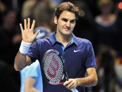 Roger Federer of Switzerland acknowledges the cheers after routing Rafael Nadal of Spain in London.