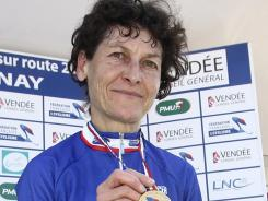 This June 24, 2010 file photo shows Jeannie Longo on the podium displaying her gold medal after winning the 24.7 km race against the clock in the French cycling championship in Chantonnay, western France.