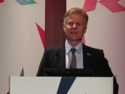 LOCOG CEO Paul Deighton addresses a session of the Olympic world press briefing on Aug. 3, 2010.