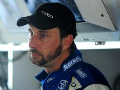 David Reutimann pauses before the season finale at Homestead-Miami Speedway. He does not have a ride for 2012, but said he was willing to take a Nationwide Series wheel if he had to.
