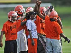 Coolidge (Washington, D.C.) football coach has seen her team improve from 4-7 last season to 8-2 this season.