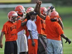 Coolidge (Washington, D.C.) football coach has seen her team improve from 4-7 last season to 8-2 this season.