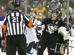 The Penguins' Sidney Crosby (87) reacts after being called for an elbowing penalty against the Blues in Pittsburgh. St. Louis won 3-2 in overtime and Crosby was held pointless in the loss.