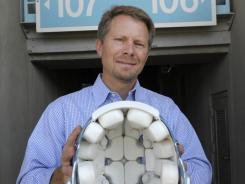 UNC researcher Kevin Guskiewicz  shows a helmet fitted with accelerometers,