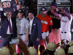 Part of the newness in Miami was unveiled this month by Marlins players, team owner Jeffrey Loria, far left, and manager Ozzie Guillen, third from left.