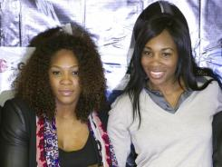 Serena, right, and Venus Williams pose at the end of a press conference in Bogota. They have met in the finals of eight Grand Slam tournaments.