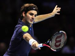 Roger Federer of Switzerland stretches fo a backhand during his three-set win Thursday against Mardy Fish of the USA.