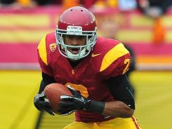 Southern California Trojans wide receiver Robert Woods runs the ball against the Washington Huskies during the first half at the Los Angeles Memorial Coliseum.