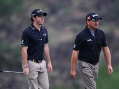 Ireland's Rory McIlroy and Graeme McDowell are tied with the team from Australia after the second round of the World Cup of Golf in China. The team shot 4 under on Friday.